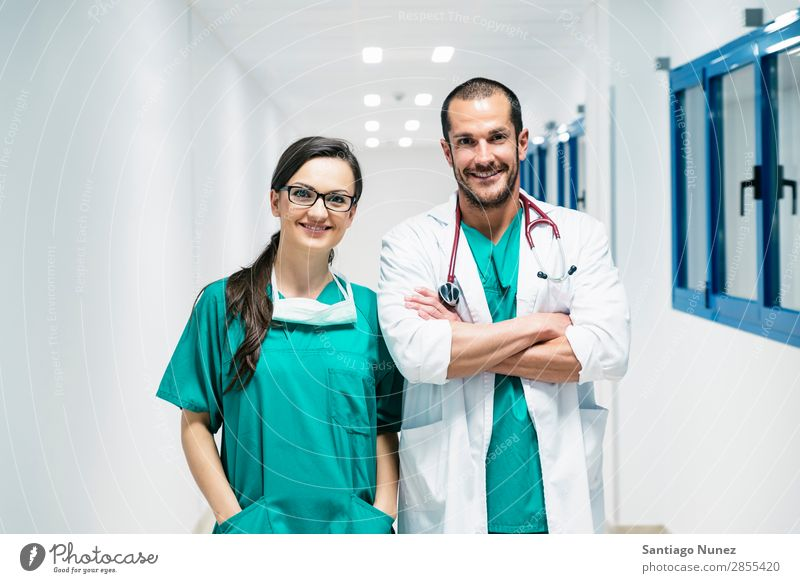 Smiling doctor and nurse portraiture. clinic Self-confident coworker Doctor examining Woman Girl Hand Happy Healthy Health care Hospital Interior shot