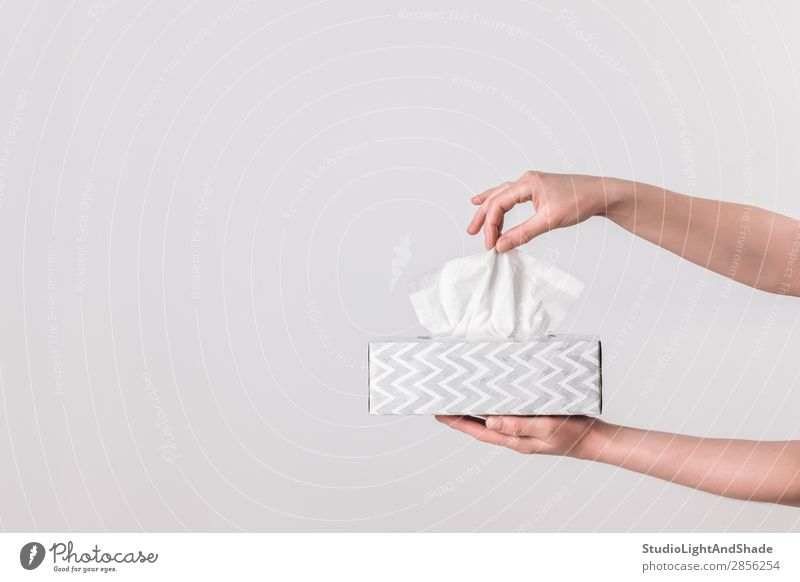 Delicate female hands holding a tissue box Woman Colour White Hand Adults Feminine Health care Style Gray Design Modern Elegant Photography Paper Simple Clean