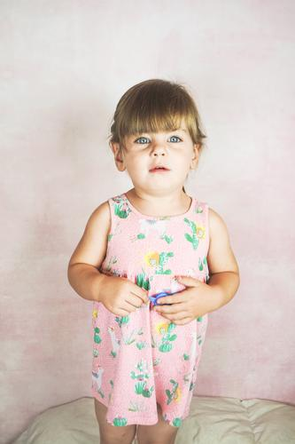 Young little and funny girl in a studio shot Lifestyle Joy Happy Face Child Baby Toddler Woman Adults Infancy Dress Blonde To enjoy Happiness Funny Cute Pink
