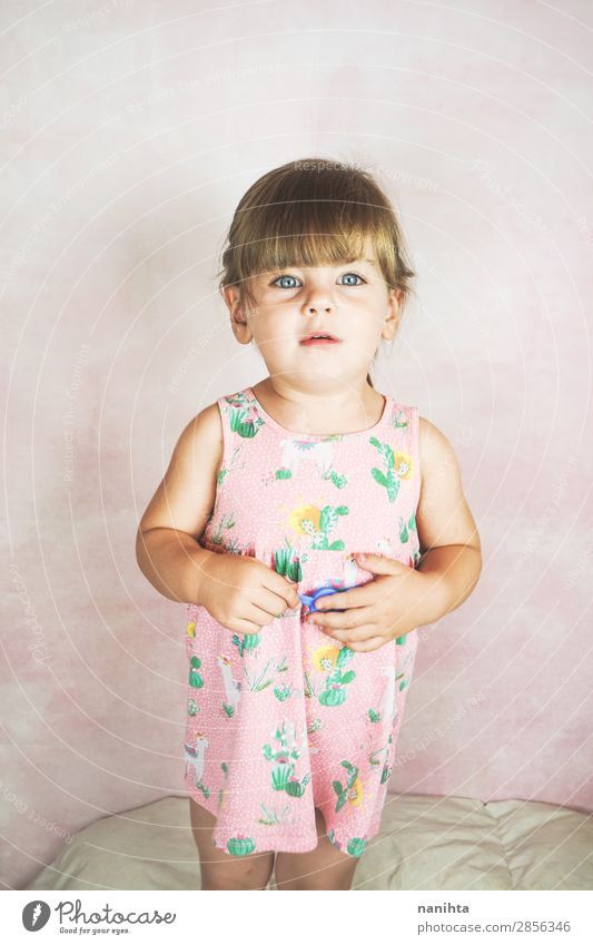 Young little and funny girl in a studio shot Woman Child Loneliness Joy Face Lifestyle Adults Funny Emotions Happy Pink Blonde Infancy Happiness To enjoy