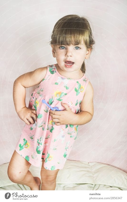 Young little and funny girl in a studio shot Lifestyle Joy Happy Face Child Human being Feminine Toddler Girl Infancy 1 1 - 3 years Fashion Dress Blonde