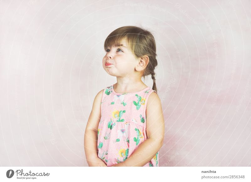 Young little and funny girl in a studio shot Child Human being Beautiful Loneliness Joy Girl Face Lifestyle Funny Feminine Emotions Pink Fresh Blonde Infancy