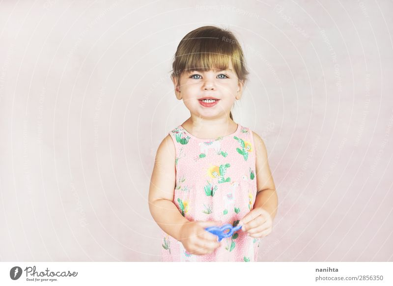 Young little and funny girl in a studio shot Lifestyle Joy Happy Face Child Human being Feminine Toddler Girl Infancy 1 1 - 3 years Dress Blonde To enjoy