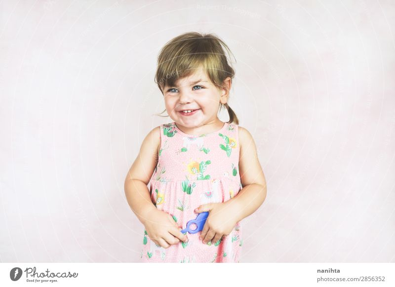 Young little and funny girl in a studio shot Lifestyle Joy Face Wellness Child Human being Feminine Toddler Girl Infancy 1 1 - 3 years Dress Blonde To enjoy