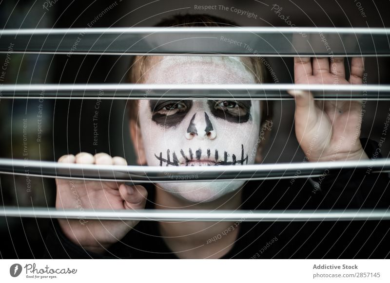 Boy with face painted like a skull Delightful Black boo Boy (child) Caucasian Child Costume Creepy Dark Dramatic Fear Funny Hallowe'en Hidden Lifestyle Make-up