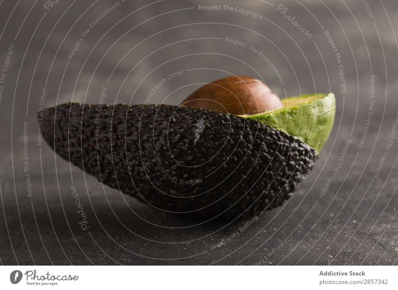 Sliced avocado on dark background Arrangement Avocado Chile cilantro Coriander Delicious Dip Exotic Food Fruit Green guacamole Healthy Ingredients Natural