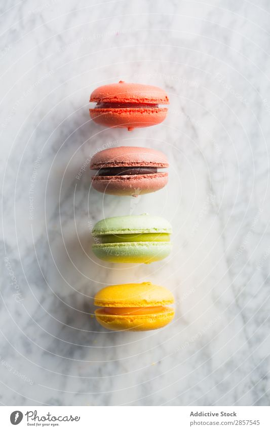 Macarons on marble table Almond Bakery biscuit Cake cantaloupe Chocolate Hot Chocolate Multicoloured Dessert Food French Home-made Lemon Marble Orange
