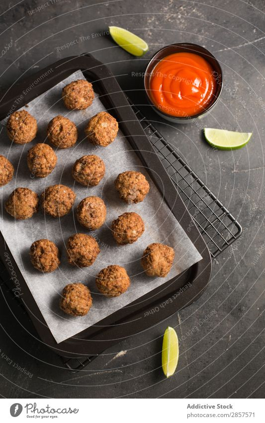 Homemade meatballs in oven tray Ball Beef Cooking Delicious To feed Food Gourmet Home-made Ingredients Italian Lunch Meal Meat minced Sauce Tomato Tradition