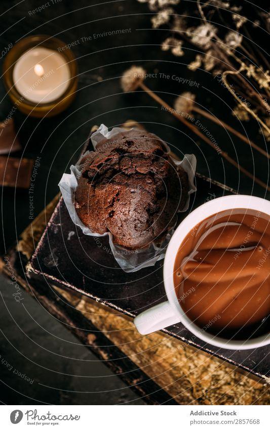 Chocolate muffin and mug with hot chocolate Baking Book Cake Candle Hot Chocolate Cupcake Dessert Drinking Food Bird's-eye view handmande Home-made Muffin Mug