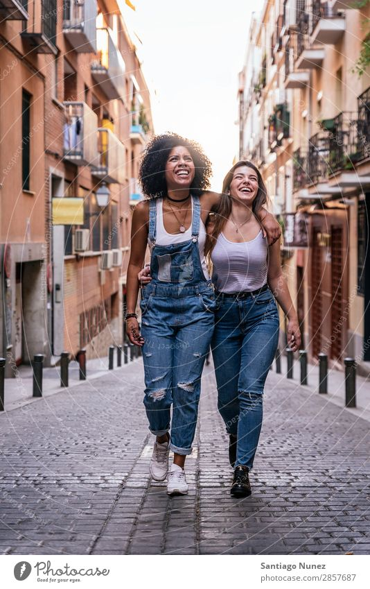Beautiful women having fun in the street. Woman Friendship Afro Youth (Young adults) Happy Summer Human being Joy Smiling Walking Girl pretty 2 Together Couple