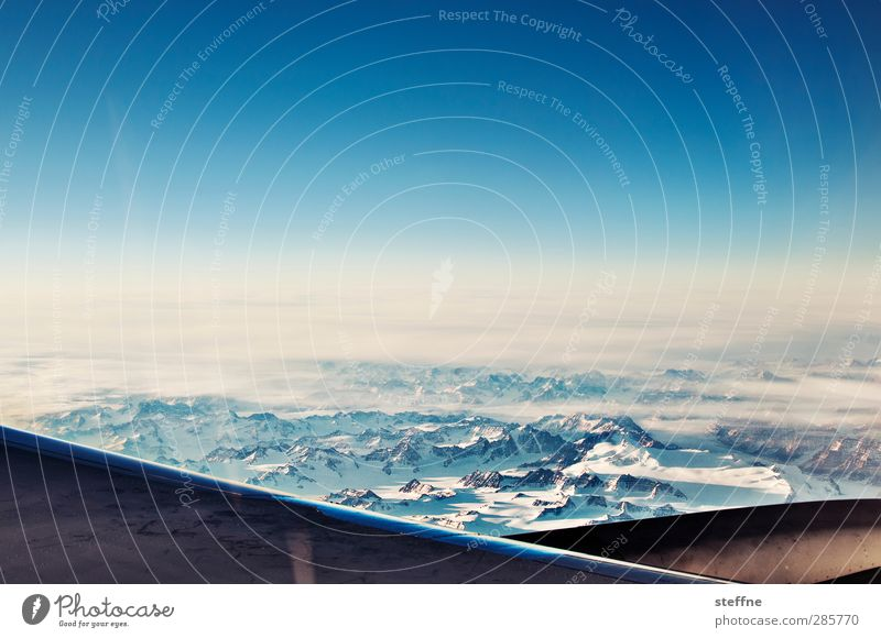 Around the World Greenland Sky Beautiful weather Mountain Peak Glacier Esthetic Exceptional Airplane View from the airplane Colour photo Exterior shot