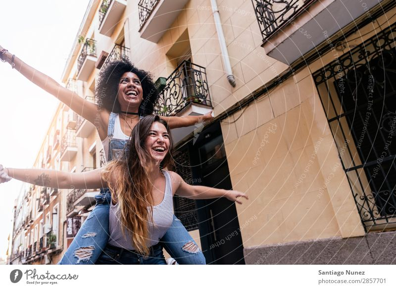 Beautiful women having fun in the street. Woman Friendship Youth (Young adults) Afro Happy Smiling Summer Human being