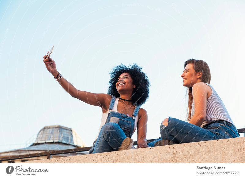 Beautiful women taking a self portrait in the Street. Woman Friendship Youth (Young adults) Happy Summer Human being Joy