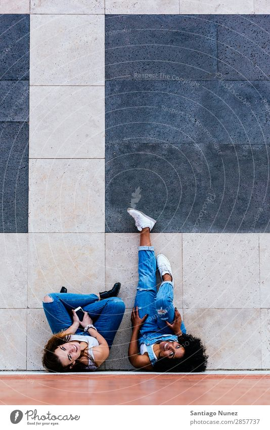 Beautiful women having fun in the street. Woman Friendship Youth (Young adults) Happy Summer Human being Joy Mobile PDA Telephone Solar cell using Communication