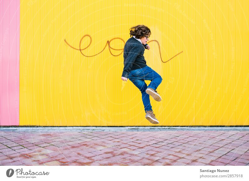 Happy boy jumping. Jump Boy (child) Child Excitement Style Youth (Young adults) Street Town Freestyle Background picture City Man Model Lifestyle Exterior shot