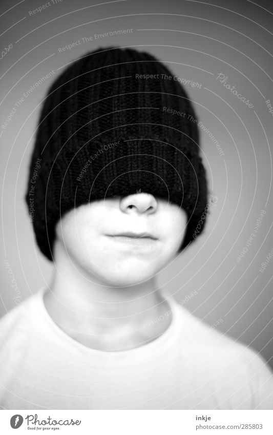 Cap (black) Style Boy (child) Infancy Life Head Face Child's portrait 1 Human being 8 - 13 years Woolen hat Exceptional Cool (slang) Dark Warmth Black Emotions