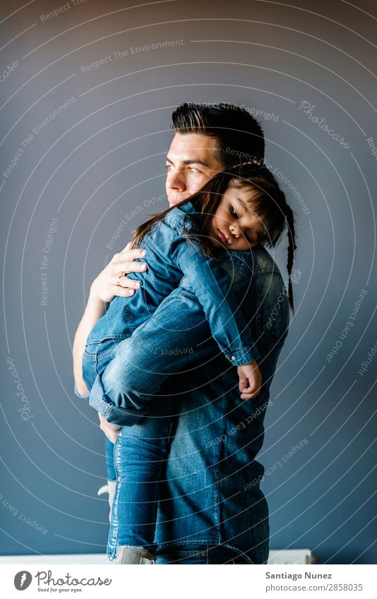 Proud father hugs his daughter. Father Baby Day Happy Considerate Embrace hugging dad Youth (Young adults) Portrait photograph Girl Daughter Child Pride Small