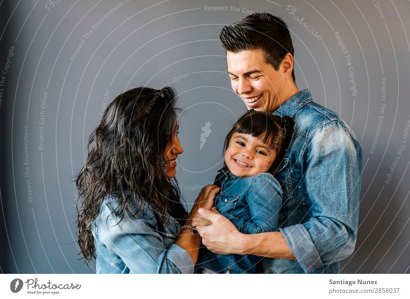 Happy young family with their daughter. Family & Relations Home Youth (Young adults) Child White Human being lifestyle mother Father Embrace Woman Parents