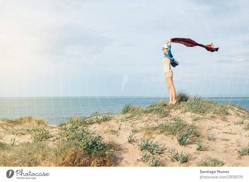 Woman walking away on the idylic beach. Beach Looking Ocean Vacation & Travel White Sun Summer Tourist Water Youth (Young adults) Relaxation Girl Caucasian