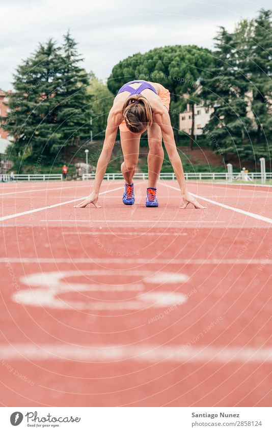 Woman getting ready to start running Athlete Track and Field Black Block blocks Clothing Self-confident Copy Space Practice Healthy Lifestyle Line 1