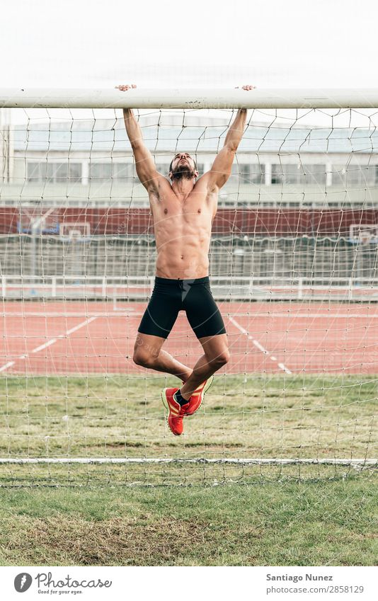 Man Doing Chin-ups outdoor. abs Action Athlete Attractive chin-up Practice Athletic Fitness Green Gymnasium handsome Healthy Horizontal instructor Lifestyle