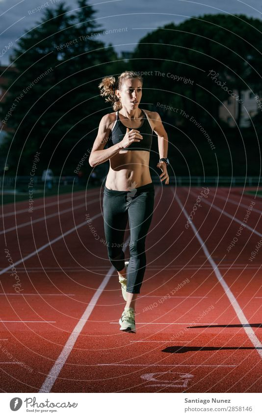 Attractive woman Track Athlete Running On Track Action athleticism cacucasian challenge Competition Self-confident Determination Practice Woman finishing