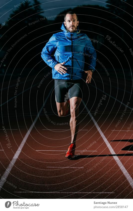 Attractive man Track Athlete Running On Track Action athleticism Beginning cacucasian challenge Competition Self-confident Determination Practice Athletic