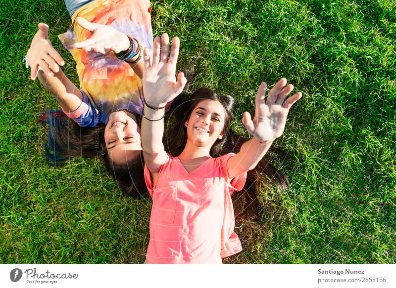 Beautiful Teenage Girls Having Fun in Summer Park. Outdoor braket Caucasian Cheerful Child Daughter Woman Friendship Joy Funny Grass Green Happy Embrace