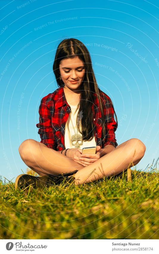 Happy Teenage Girl Using Mobile In Park Youth (Young adults) teenage Communication American Attractive Beautiful braket Caucasian Solar cell Cellphone