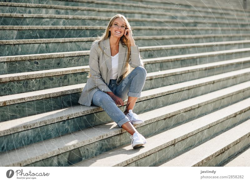 Beautiful young blonde woman smiling on urban steps. Lifestyle Style Happy Hair and hairstyles Human being Feminine Young woman Youth (Young adults) Woman