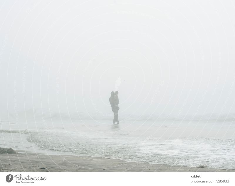 fog Summer vacation Beach Ocean Waves Aquatics Swimming & Bathing Child Man Adults Father Body 2 Human being Clouds Bad weather Fog Rain Coast Freeze