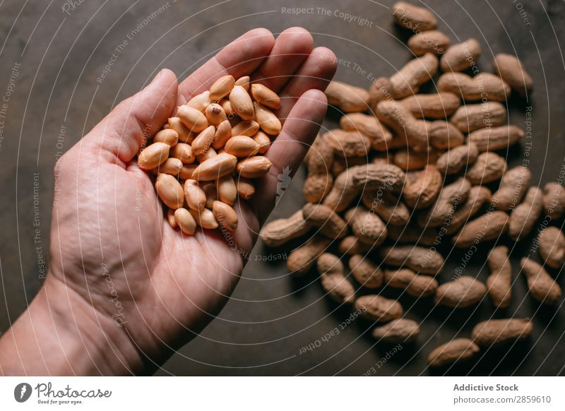 Man holding peanuts Agriculture assortment Background picture Chopping board Dry Food Fresh Fruit Hand Healthy Hold Ingredients Nut Raw Rustic Scoop Shell Wood