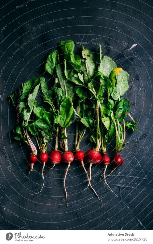 Radish on dark background Dark background Ecological Food Fresh Green Harvest Healthy Ingredients Leaf Organic Red Vegetable Vegetarian diet