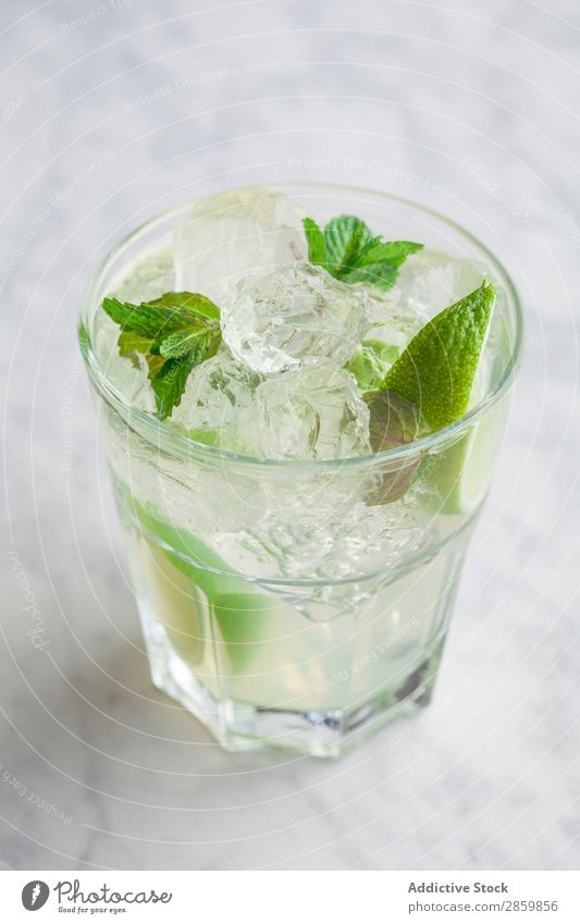 Glass of mojito with rum, lime and mint Alcoholic drinks barman bartender Beverage Cocktail Cold Drinking Fresh garnish Gin Ice Juice Lemon Lime Mint mixologist