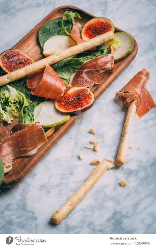Healthy salad with lettuce, figs, prosciutto and pear Appetizer Cheese Delicious Diet Fig Food Fresh Fruit grissini Ham Lettuce Marble Meal Napkin Natural Nut