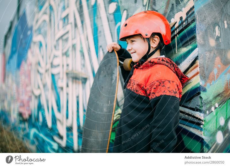 Kid with long board Board Boy (child) Caucasian Court building Graffiti Helmet learn Longboard Exterior shot Park Playing Protection Ice-skates Skateboard