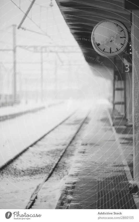 Frozen clock in snowy train station Antique Clock Cold Frost Industrial Exterior shot Platform Railroad Retro Snow snowing Station Train station Transport