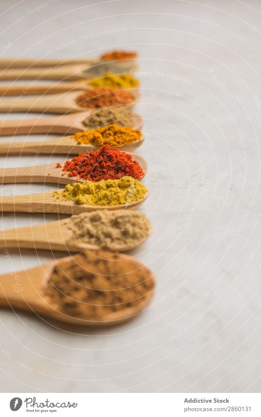 Different spices in wooden spoons Aromatic Background picture Cinnamon Clove condiment Copy Space Coriander Cumin curry Dark Dry flat lay Food Bird's-eye view