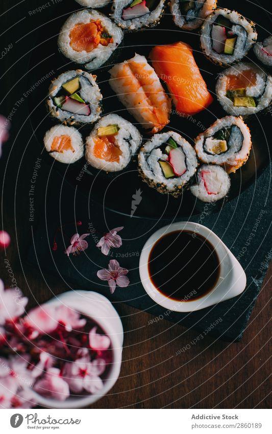 Sushi served on blackboard asian Avocado Chopstick Dish Fish Flower Food Ginger Japanese maki nigiri nori Raw Rice Salmon sashimi Seafood Smoked salmon