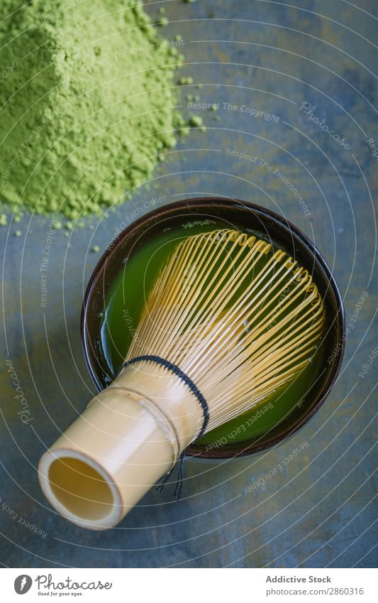 Preparing matcha tea with bamboo whisk Bamboo Beverage brew Green Healthy Japanese Powder Tea Beater