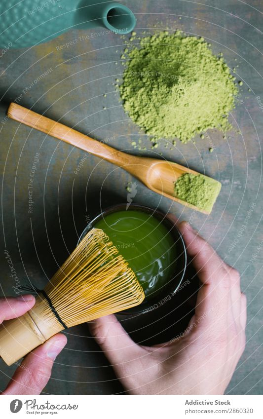 Preparing matcha tea with bamboo whisk Bamboo Beverage brew Green Hand Healthy Japanese Man Powder Scoop Spoon Tea Beater