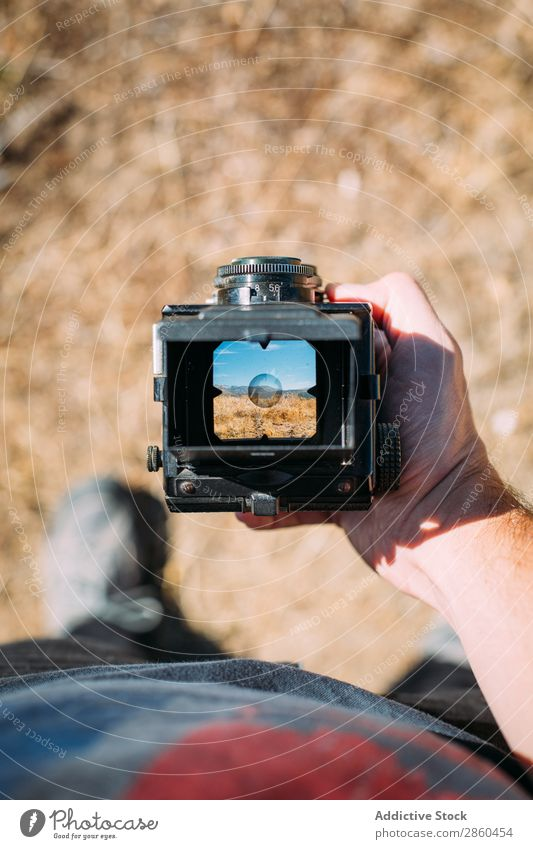 Landscape through the viewfinder of an old camera Analog analogical Camera collectable Film Hand Hold Lens Medium format Old fashioned Exterior shot Photography
