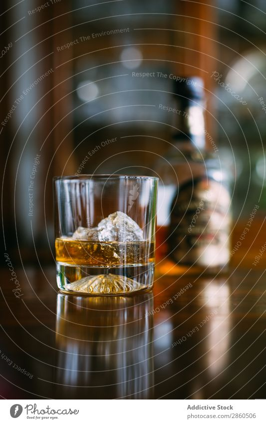 Glass of whiskey on the rocks Alcoholic drinks Amber Background picture Bar barman bartender Beverage Bottle Bourbon Brandy Cognac Day Drinking Gold Ice
