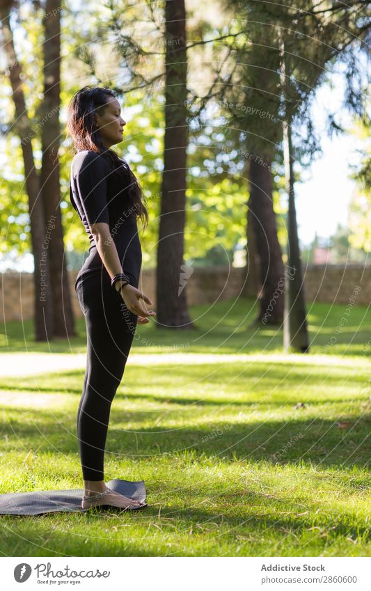Young Woman Practicing Yoga Outdoors A Royalty Free Stock Photo From Photocase