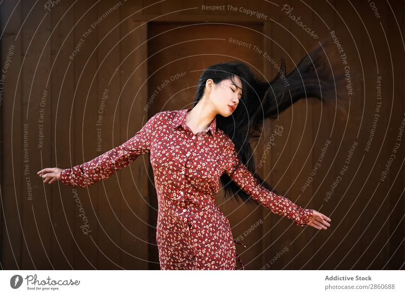 Asian woman shaking hair Woman Youth (Young adults) Attractive Dress Red asian Japanese Hair Joy eyes closed Brunette Beautiful Beauty Photography Human being