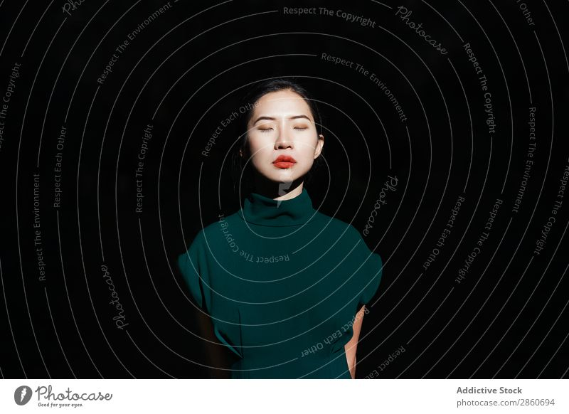 Asian woman with eyes closed in the forest Woman Youth (Young adults) Attractive Dress Green asian Japanese black background Park Relaxation Rest Calm Peaceful
