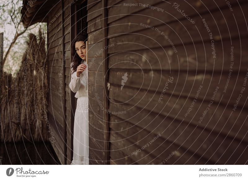 Dreaming model in white leaning wall Woman Rustic Dress Vintage Rural House (Residential Structure) Clothing Style Loneliness Old fashioned Wall (building)