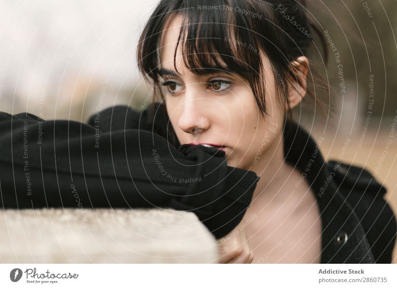 Melancholic woman in black leaning on fence Woman To enjoy Pensive Sadness Brunette Sensitive Fence Lean Dream Beautiful tender Remote tranquil