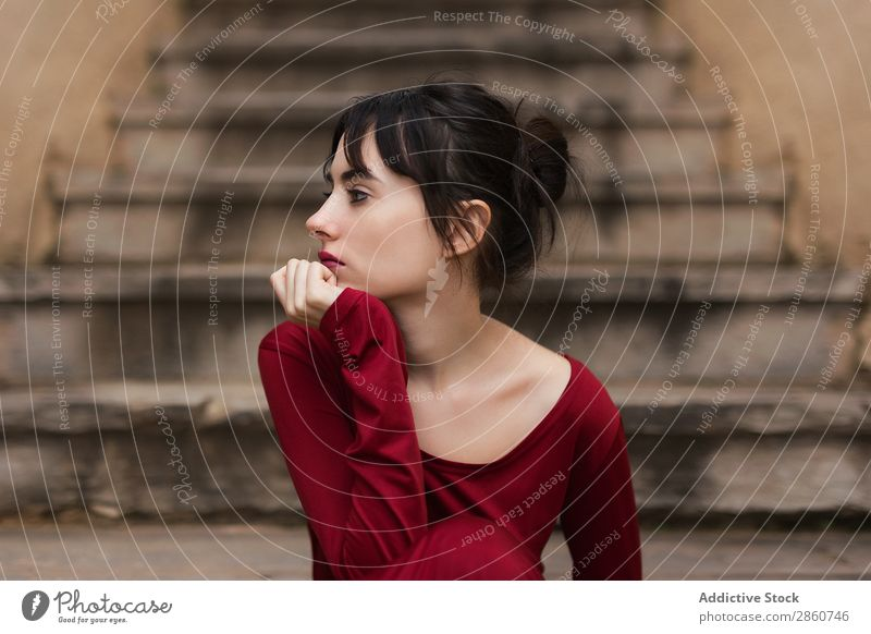 Tender girl in red looking away Woman Vulnerable Beauty Photography Eyes Looking Sit Posture To enjoy Stairs Fashion Red Graceful Considerate tender Delicate