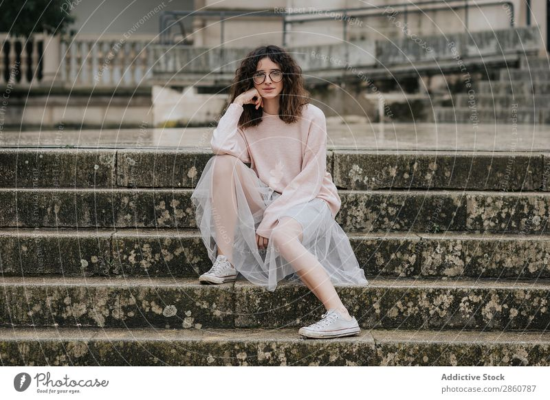 Stylish woman in skirt sitting on steps Woman Style Steps Skirt Person wearing glasses Sneakers pretty Dress Hip & trendy romantic Veil Brunette Wet Stairs